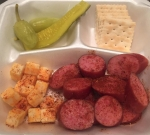 Sausage and Cheese Plate with saltines, pickle spear, and banana peppers by MIDSOUTH BBQ The Yellow Trailer in Covington and Atoka TN